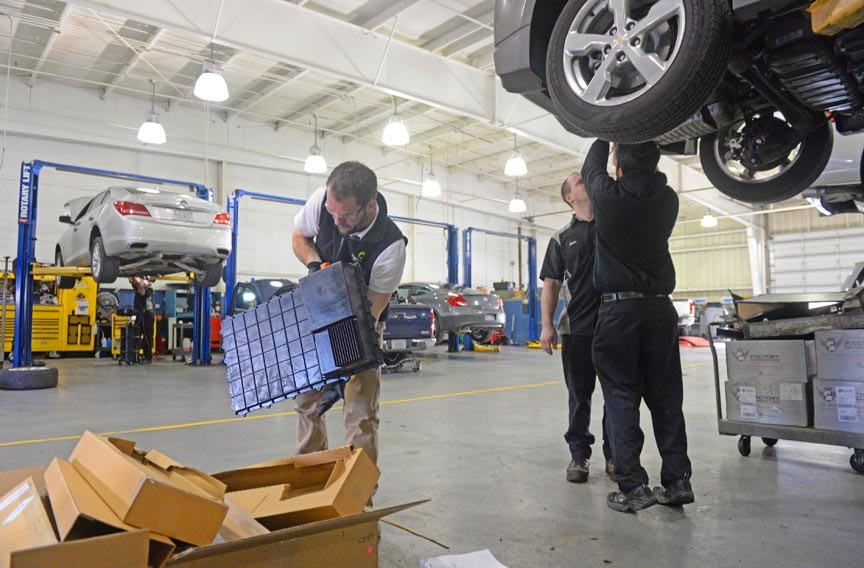 Technicians learn how to install a Plugless Power wireless recharging system at Rick Hendrick Chevrolet Buick GMC in Short Pump. - SCOTT ELMQUIST