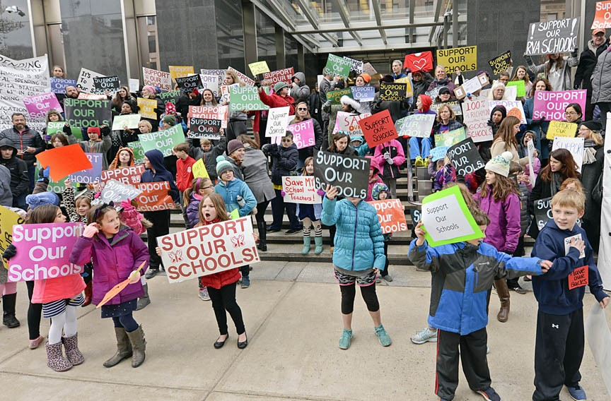 Roughly 150 infuriated students, parents and teachers gather at City Hall in February to call for teacher raises and increased funding to fix deteriorating buildings. The rally came as the school system continues to hash out a budget with the city for the next fiscal year. - ASH DANIEL