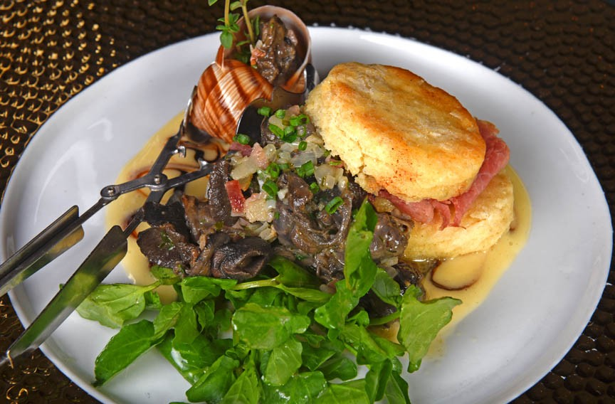 Shannon's Southern background and French culinary training result in dishes such as this one: escargot with a ham biscuit surrounded by a garlic beurre blanc. - SCOTT ELMQUIST