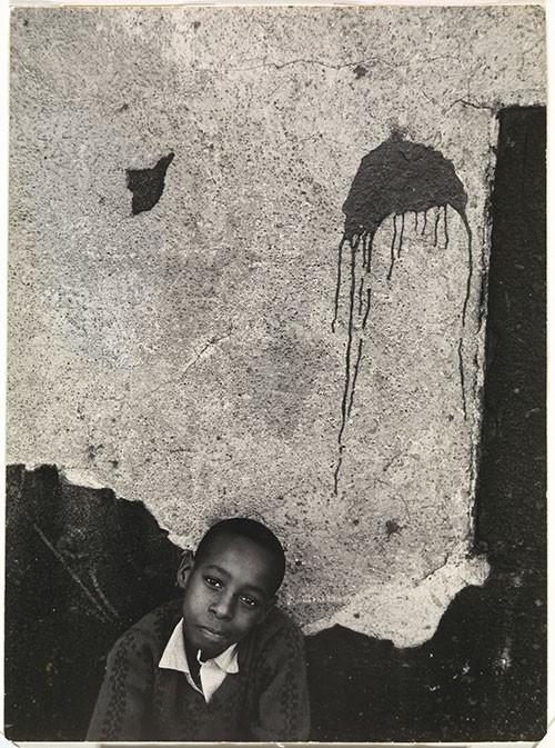 Louis Draper (American, 1935-2002) Boy with Paint Splatter, undated, gelatin silver print. Virginia Museum of Fine Arts, Arthur and Margaret Glasgow Endowment.