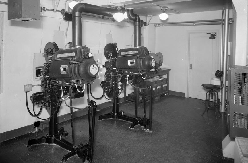 Before digital: the Westhampton's projection booth circa 1946. - DEMENTI STUDIO