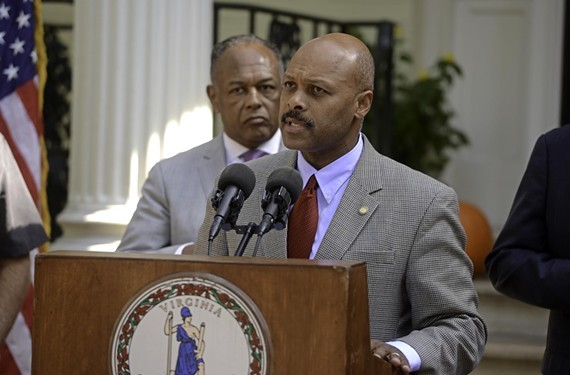With Mayor Dwight Jones in the background, Maurice Jones speaks during an economic development announcement about Stone Brewing coming to Richmond in 2014. - SCOTT ELMQUIST / FILE