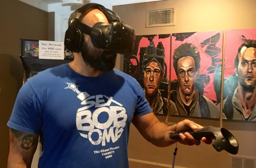 Richmond gamer Francisco Mendez tests the HTC Vive virtual reality headset in Carytown's Garden Grove Brewery. - COLBY ROGERS