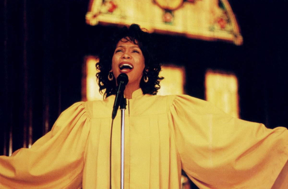 """Whitney Houston's 1996 movie """"The Preacher's Wife,"""" with Denzel Washington, continued her momentum with big grosses at the box office and at CD shops with the soundtrack. - BUENA VISTA PICTURES"""