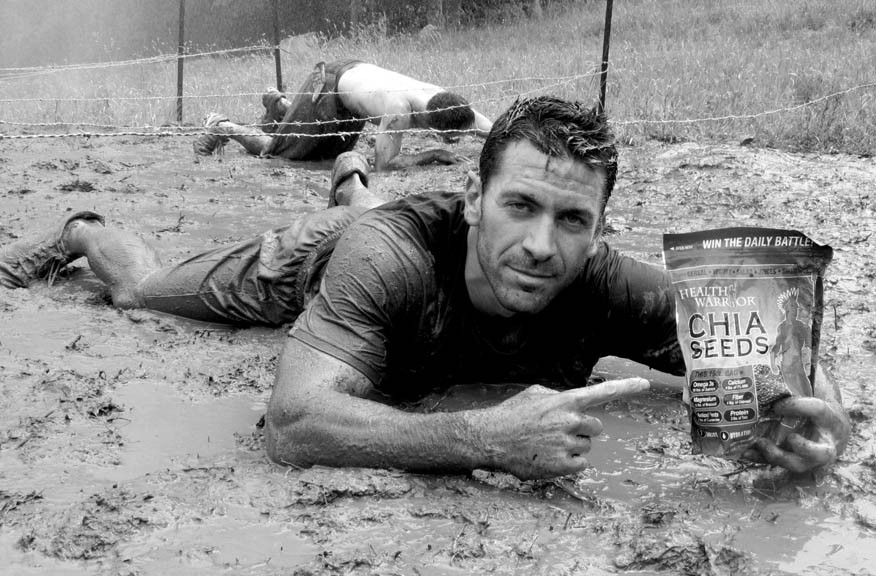 Co-founder Dan Gluck finds the strength to plug Health Warrior during the grueling obstacle course of the Spartan Race. - DAN GLUCK