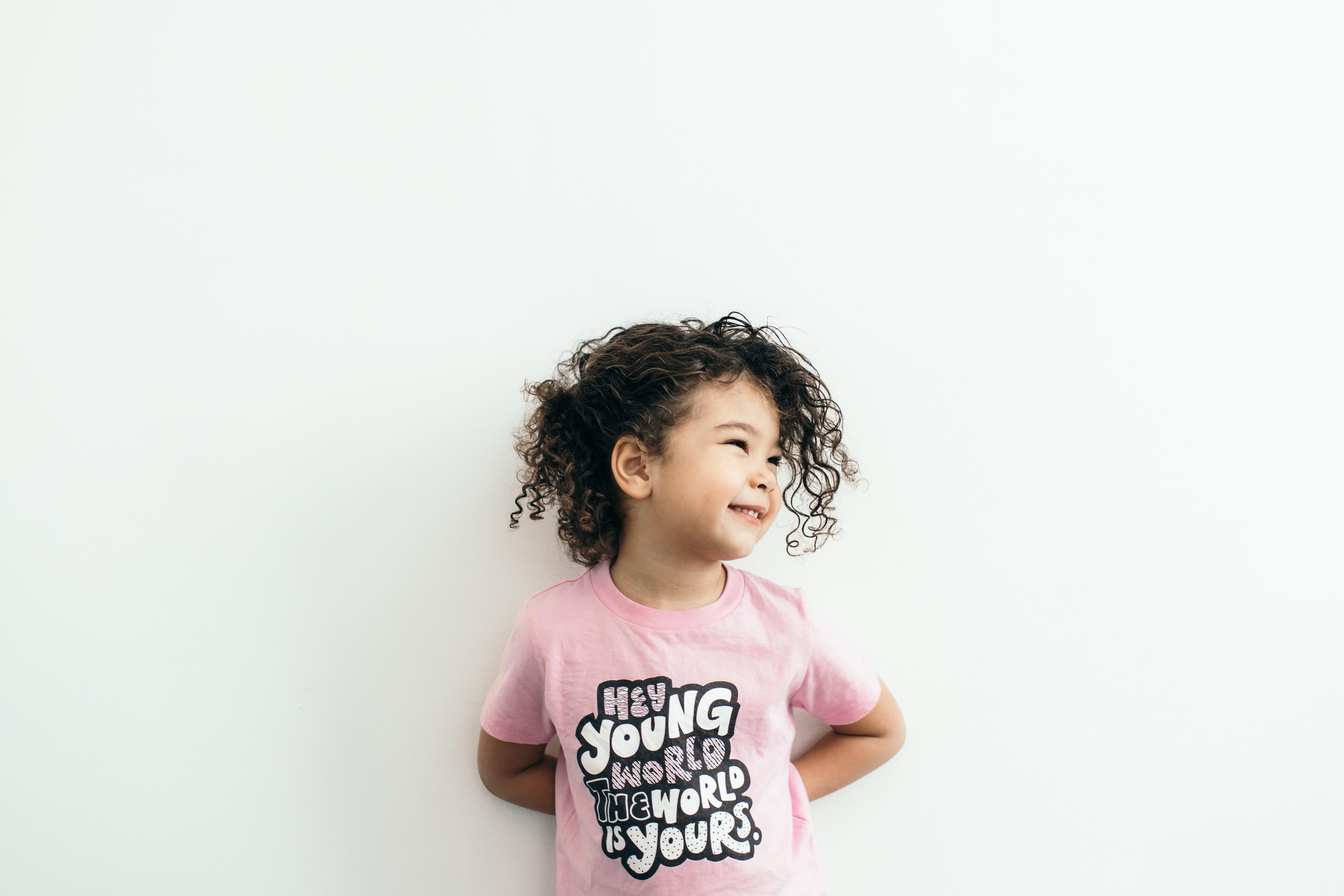 Devan Bryant, 4, models one of the shirts from her parents' clothing line, Little Nomad.