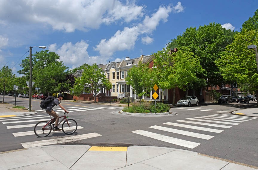 In early discussions of the Floyd Avenue infrastructure changes, city officials proposed diverters, which would reroute cars off the road in favor of bicycles. Curb extensions and miniroundabouts like this one emerged from the public debate. - SCOTT ELMQUIST