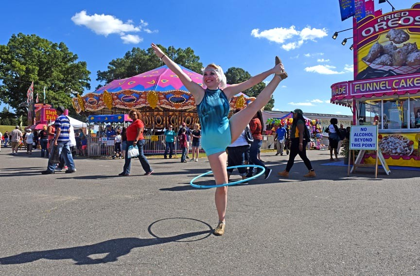 Scarlett Starlett performs with the Circular Expression Hula Hoop Show of Richmond, which will be on the midway throughout the fair's schedule. At night, the show troupe performs with fire. - SCOTT ELMQUIST