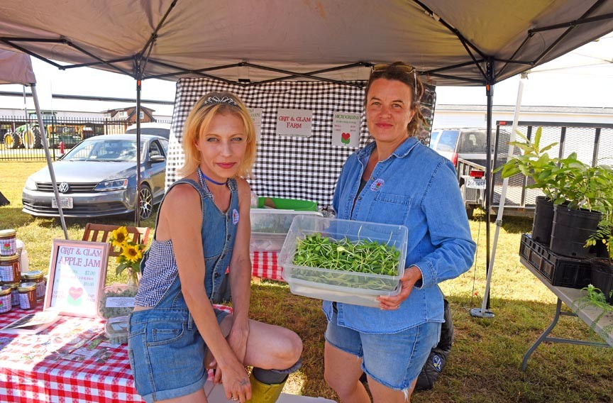 Grit and Glam Farm owners Carolina Donahue and Holli Elliot of Milford, Virginia, sell micro-greens, pork, eggs and apple jam cooked over an open fire for hours in a 150-year-old copper kettle. - SCOTT ELMQUIST