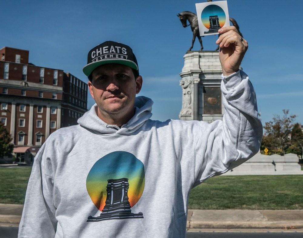 Model DJ Mentos wears the New Legacy hoodie designed by artist Noah Scalin.