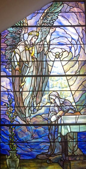 The angel Gabriel informs Mary that she will bear the son of God in this Tiffany Studios window at St. Paul's Episcopal Church. - SCOTT ELMQUIST