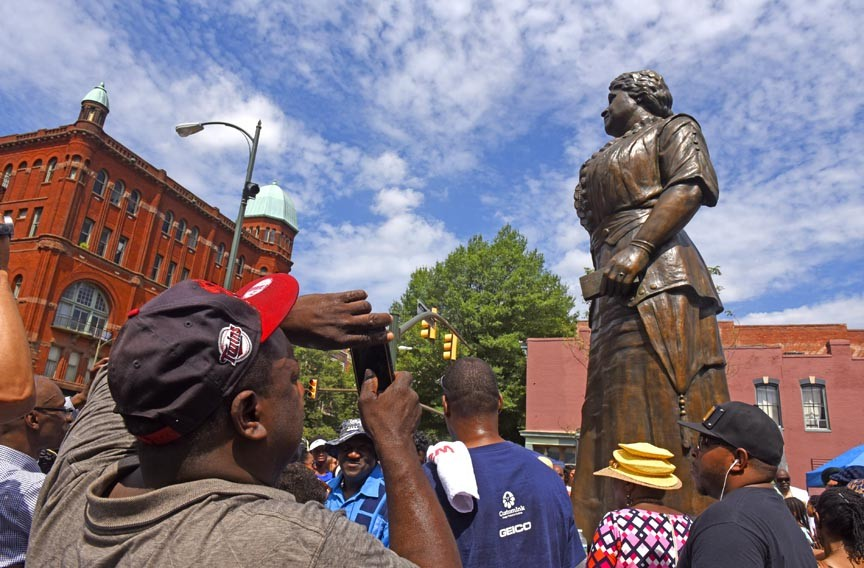 A festive crowd of about 600 people gathered all day for the unveiling of the Maggie Walker statue, the first Richmond woman to be honored among the city's outdoor monuments. - SCOTT ELMQUIST