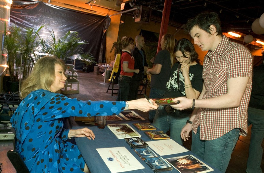 "Actress Lynn Lowry (""Shivers"" and ""I Drink Your Blood"") signs memorabilia at the 2005 festival. - PHOTO COURTESY THE JAMES RIVER FILM FESTIVAL"