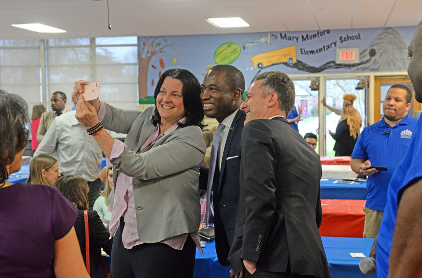 Kamras takes time for a selfie with Mayor Levar Stoney before addressing a crowd at Mary Munford Elementary School. - SCOTT ELMQUIST