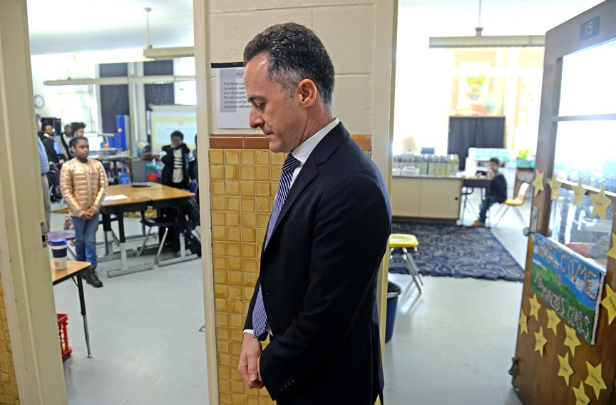 Kamras observes a moment of silence before classes at Westover Hills Elementary School. - SCOTT ELMQUIST