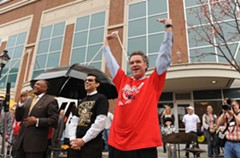 University of Richmond President Ed Ayers, right, goes for a roof-raising cheer beside Virginia Commonwealth University President Michael Rao. Mayor Dwight Jones speaks at the rally held at the Turning Basin before the Rams and Spiders headed for San Antonio. - SCOTT ELMQUIST