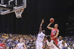 University of Richmond senior Kevin Smith shoots over Kansas defenders during Friday's game, which ended in a 20-point loss to the Jayhawks. - SCOTT ELMQUIST