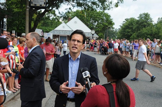 U.S. Rep Eric Cantor talks with a reporter during a rally for Republican presidential candidate Mitt Romney at Randolph-Macon College in Ashland. - SCOTT ELMQUIST