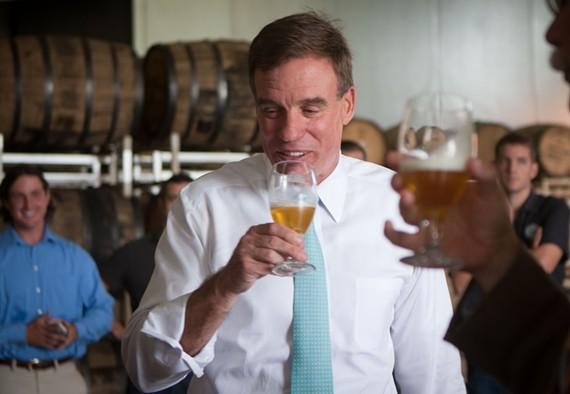 U.S. Sen. Mark Warner samples Hardywood's Singel during a tour of the brewery Wednesday morning. - NED OLIVER