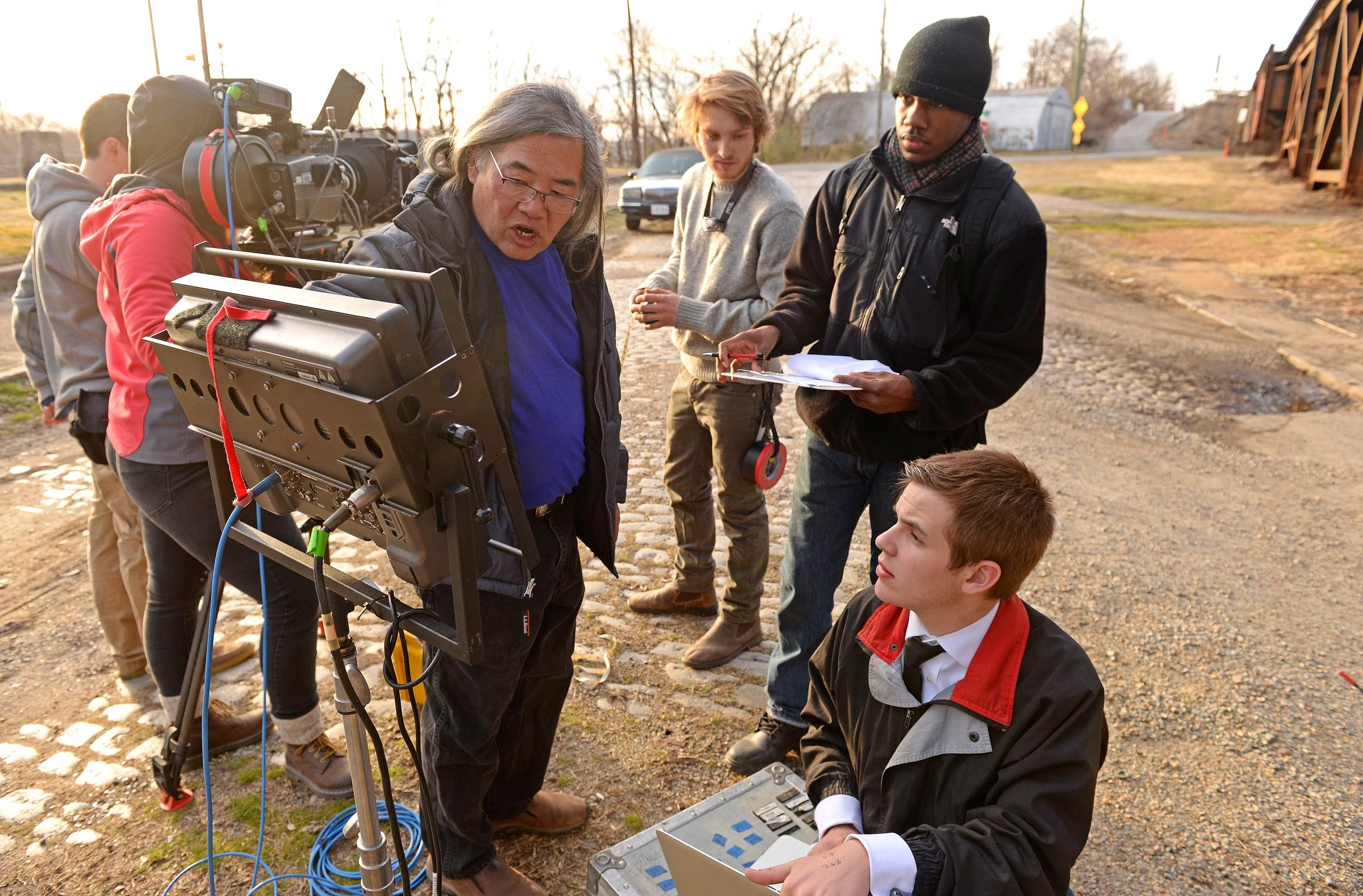 """VCU adjunct professor Art Eng, left, instructs students, including, from right, script supervisor Nick Atanasio, video assistant Payton Harbour and VCU cinema alumnus and assistant camera, Caleb Plutzer. The cinema department also is offering a class comparing film depictions of """"Macbeth"""" with Macfadyen's production. - SCOTT ELMQUIST"""