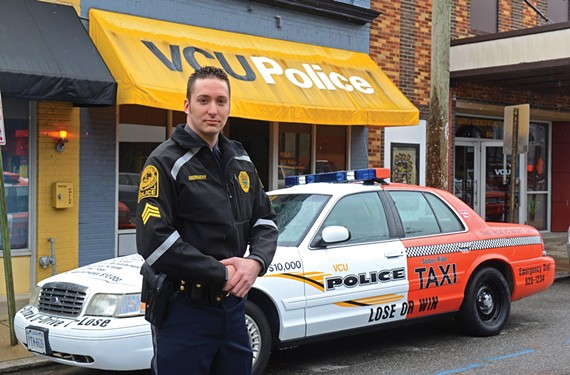 VCU police officer Joel Abernathy, who has made 26 drunken-driving arrests so far this school year, in front of the department's new half-taxi, half-police car. - SCOTT ELMQUIST