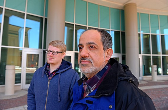 VCU professor and Muslim Student Association adviser Imad Damaj, foreground, with association member Charlie Turner, are among those who express concerns about Islam Life Radio's conservative interpretation of Islam. - SCOTT ELMQUIST