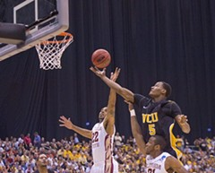 VCU's Juvonte Reddic shoots over Florida State defenders during Friday's game, the signature defensive grudge match of the tournament. - SCOTT ELMQUIST