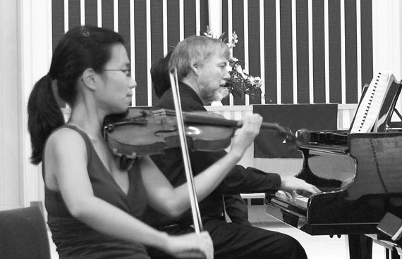 Violinist Susy Yim and artistic director and pianist John Walter are two of the Richmond Chamber Players, a 10-member ensemble of noted musicians performing four concerts in August at Bon Air Presbyterian Church.