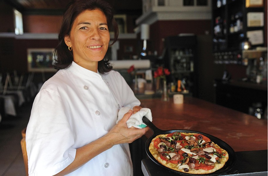 Virginia Rowland shows one of the skillet pizzas now on the menu at the restaurant. - SCOTT ELMQUIST