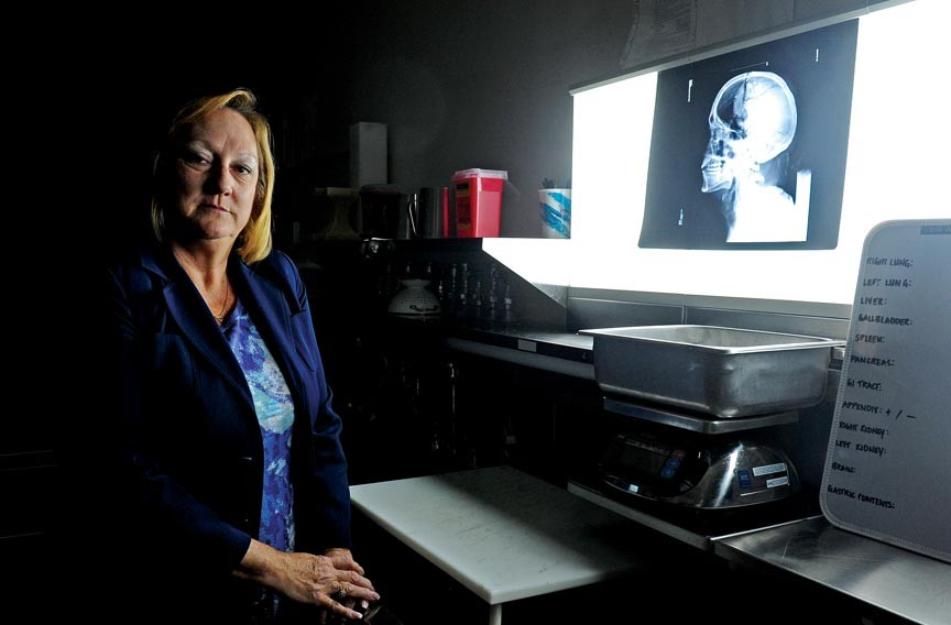 Virginia's chief medical examiner, Leah Bush, oversees about 6,000 cases a year, half of which include autopsies. - SCOTT ELMQUIST