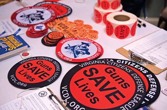 """Virginia's Libertarians have found an ally in the Virginia Civil Defense League, which decries gun control. Some party members openly carried handguns at the convention while more sport """"Guns Save Lives"""" stickers. - SCOTT ELMQUIST"""