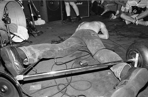 "Vocalist and guitarist Guy Picciotto from Fugazi is face-down in this photograph from the music documentary ""Salad Days: a Decade of Punk in Washington, D.C. (1980-90)."""