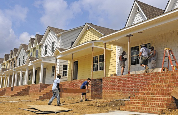 Volunteers work to finish the first houses in the Pillars at Oakmont development in Church Hill. - SCOTT ELMQUIST