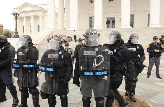 Wearing SWAT gear, state troopers protected the Capitol steps from women, men and children who were protesting anti-abortion legislation in early March. - SCOTT ELMQUIST