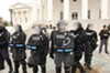 Wearing SWAT gear, state troopers protected the Capitol steps from women, men and children who were protesting anti-abortion legislation in early March.