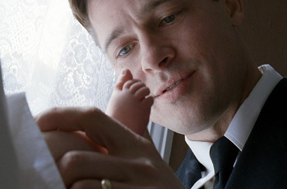 """Where God lives: Brad Pitt marvels at his newborn son in Terrence Malick's """"The Tree of Life."""" - MERIE WALLACE"""