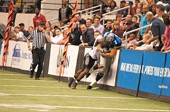 Wide receiver Rodney Landers is stopped after a catch by a defensive back from the Trenton Steel on opening night, March 19. There are no sidelines in arena football, just walls. - SCOTT ELMQUIST