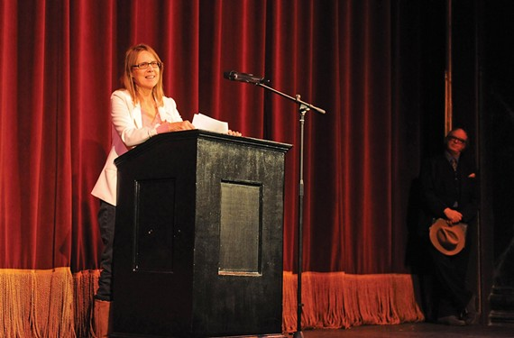 With Harry Kollatz Jr. standing by, Carol Piersol addresses a crowd of about 250 supporters at Virginia Repertory's November Theater on Dec. 22, a week after she was forced to resign from the Firehouse. - SCOTT ELMQUIST