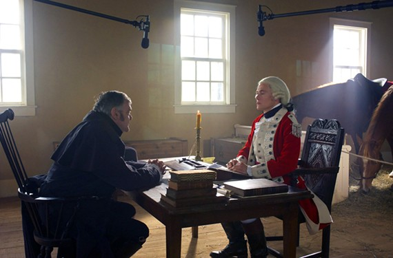 With his horses inside a church that serves as a makeshift headquarters, Maj. Hewlett, played by actor Burn Gorman, confers with Judge Woodhull, played by Kevin R. McNally. Woodhull is a loyalist while his son, Abe, fights for a different cause. - ANTONY PLATT/AMC