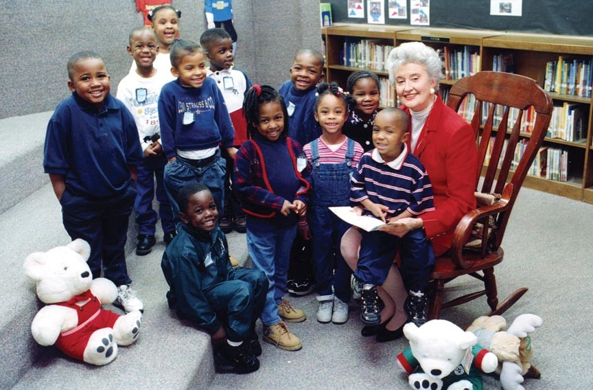 With Snow Bear nearby, Betty Bauder reads to children as Richmond's Christmas Mother in 1998.