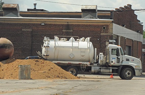 Workers are digging up fuel tanks the old GRTC Transit depot. - SCOTT ELMQUIST