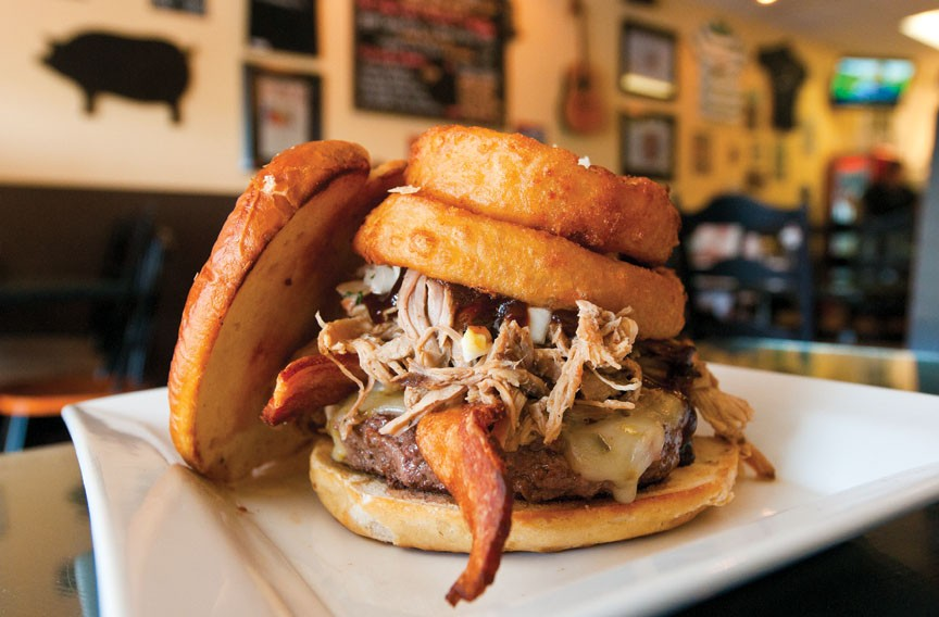 Yes, it's the hogburger, with bacon, pulled pork, onion rings, cheese, slaw and sauce on a pretzel roll. - SCOTT ELMQUIST