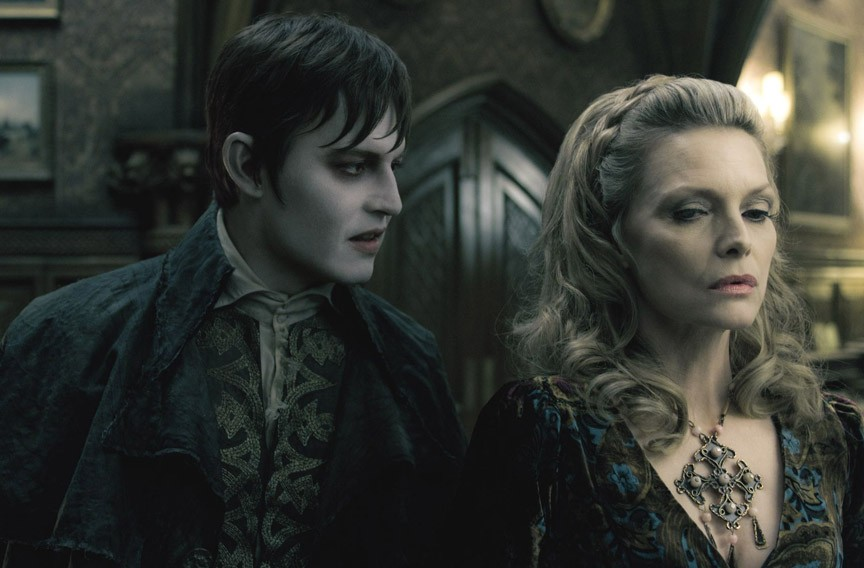 """You're dead to me."" Johnny Depp and Michelle Pfeiffer share a mutual disdain for garlic and sunshine in Tim Burton's hilarious re-take of the vampire soap opera, ""Dark Shadows."" - PETER MOUNTAIN"