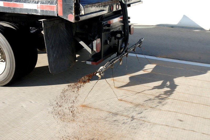 A Tennessee department of transportation truck applies beet juice to roadways in advance of a storm. - TENNESSEE COMMUNICATIONS