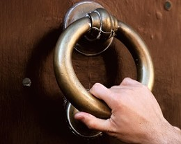 hand-knocking-at-door.jpg