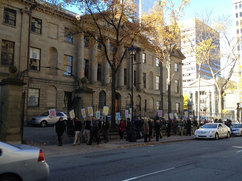"About 50 NSGEU members picketed province house Thursday, chanting ""outsource the NDP."""