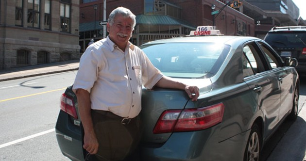 Ali, a Casino Taxi driver, waits for customers at a cab stand in downtown Halifax. - HILARY BEAUMONT