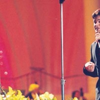 Augusto Enriquez sings on Thursday night (but not with Pavarotti).