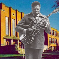 Black and white image of B.B. King playing guitar overlaid on a colour picture of QEH School