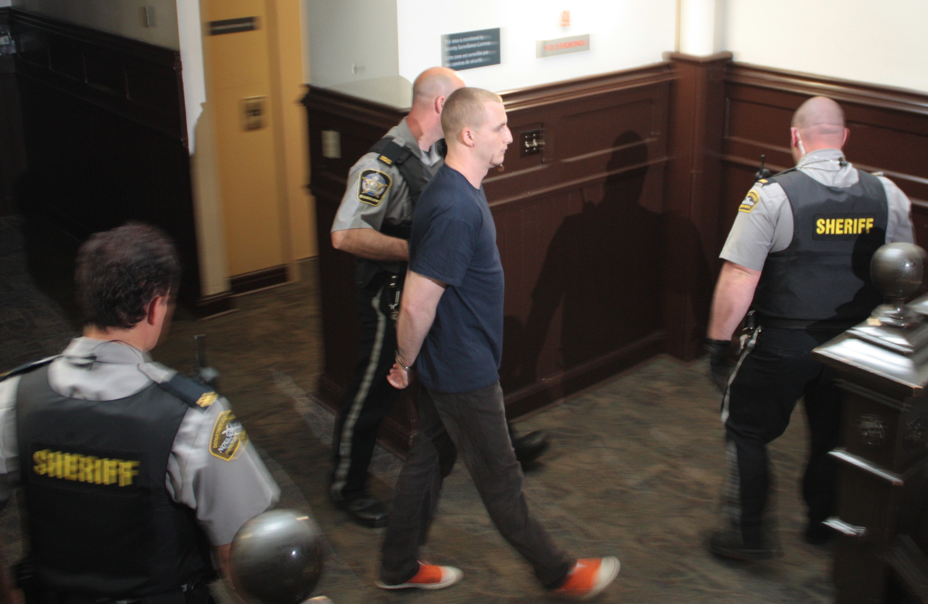 Blake Leggette, accused of the first-degree murder of Loretta Saunders, is escorted by sheriffs at Halifax provincial court on Monday. - PHOTO HILARY BEAUMONT